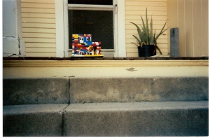 Our porch, and Michael's intricately build lego house of OUR house.  Not pictured: the rooms and layout of our house exactly as it looked...just made out of legos.